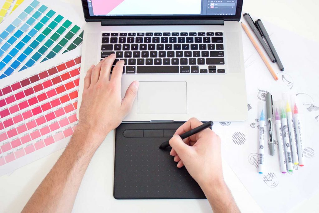 Graphic Designer Disigning with laptop and Digital notepad